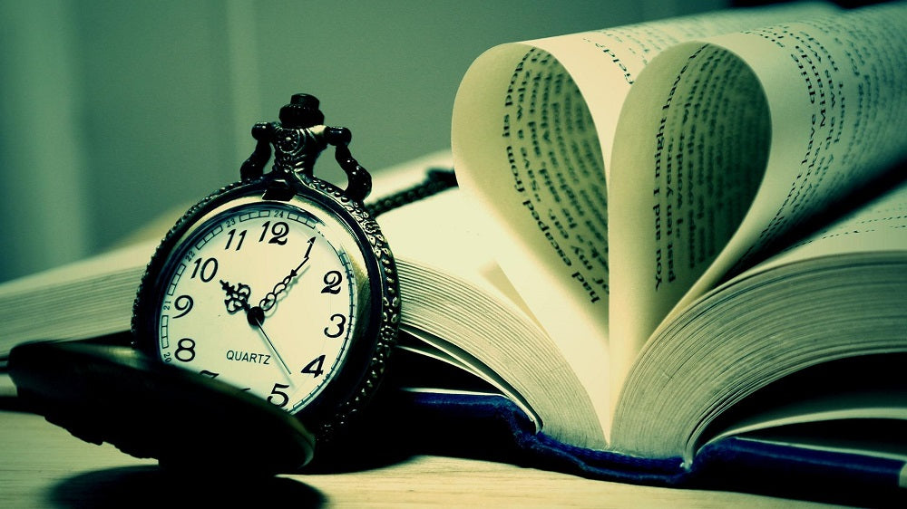 book and a pocket watch
