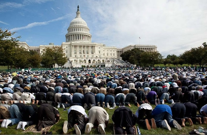 Muslims praying in front of Capitol Hill