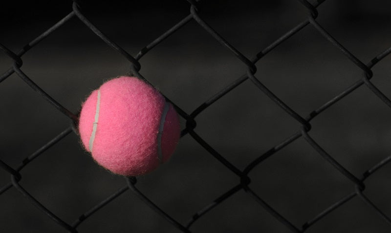 pink tennis ball, breast cancer awareness
