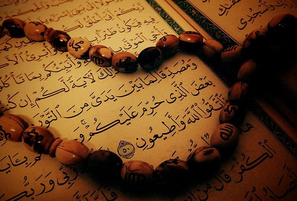 prayer beads and Quran