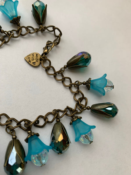 Teal Flowers and Crystals Charm Bracelet