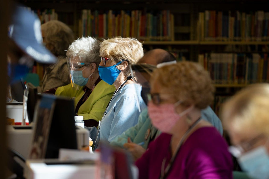 Poll Workers wear protective Equipment while assisting voters Wednesday at an early voting station in Nashville, Tenn. Photo: Brett Carlsen / Getty Images