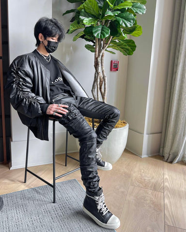 Men streetwear outfit ideas - black leather jacket, mask, stacked pants, high top sneakers