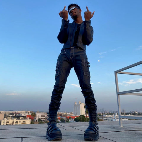 lil nas x in waxed black stacked denim jeans