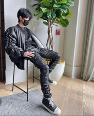 Black leather, face mask, and stacked pants