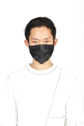 A man wearing vegan python leather black face mask with white tee shirt outfit