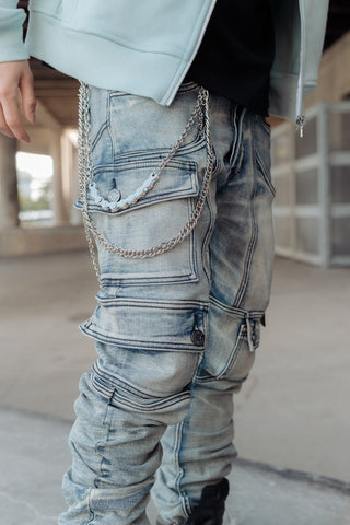 Kyle blue cargo jeans paired with silver biker pant chain