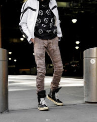 Waist down photo with stacked pants and sneakers