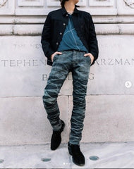Waist down photo with stacked pants and nice sneakers