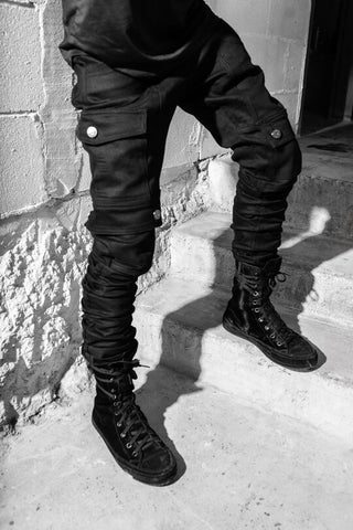 Solid black outfit cargo pants stacked denim and black high top sneakers men