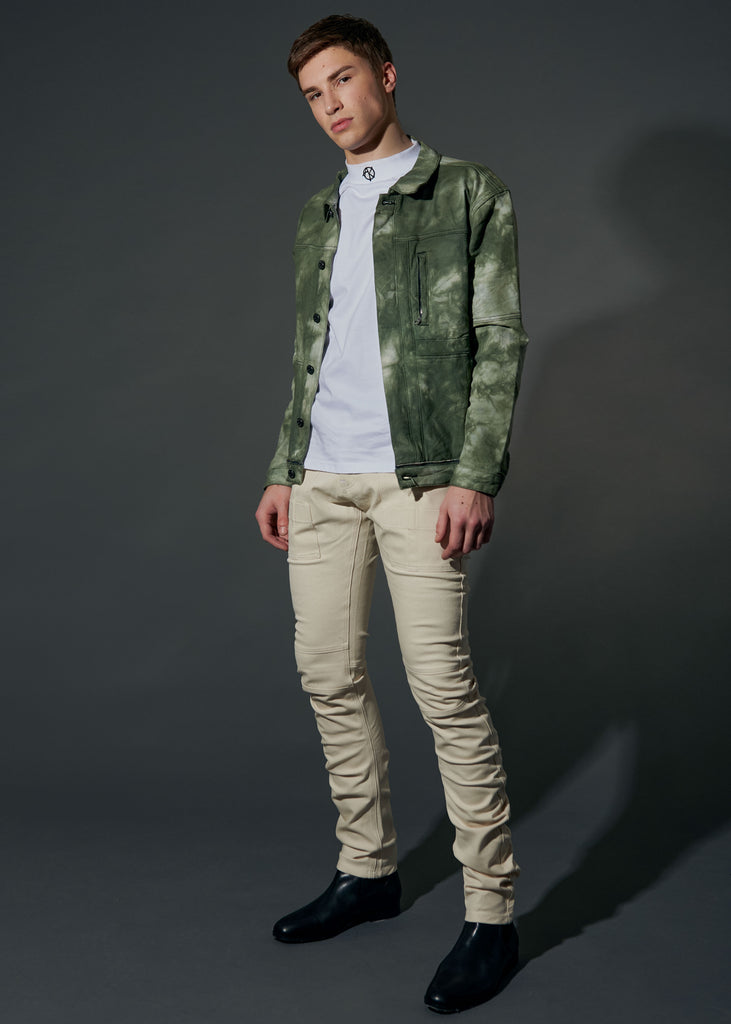 full body shot of model wearing the daniel cream jean styled with the victor green jacket and the AK logo mockneck