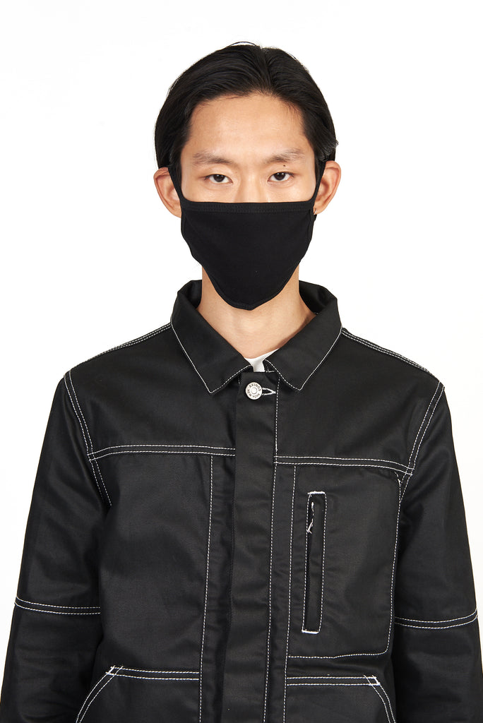 front view of model wearing the akings cotton face mask in black