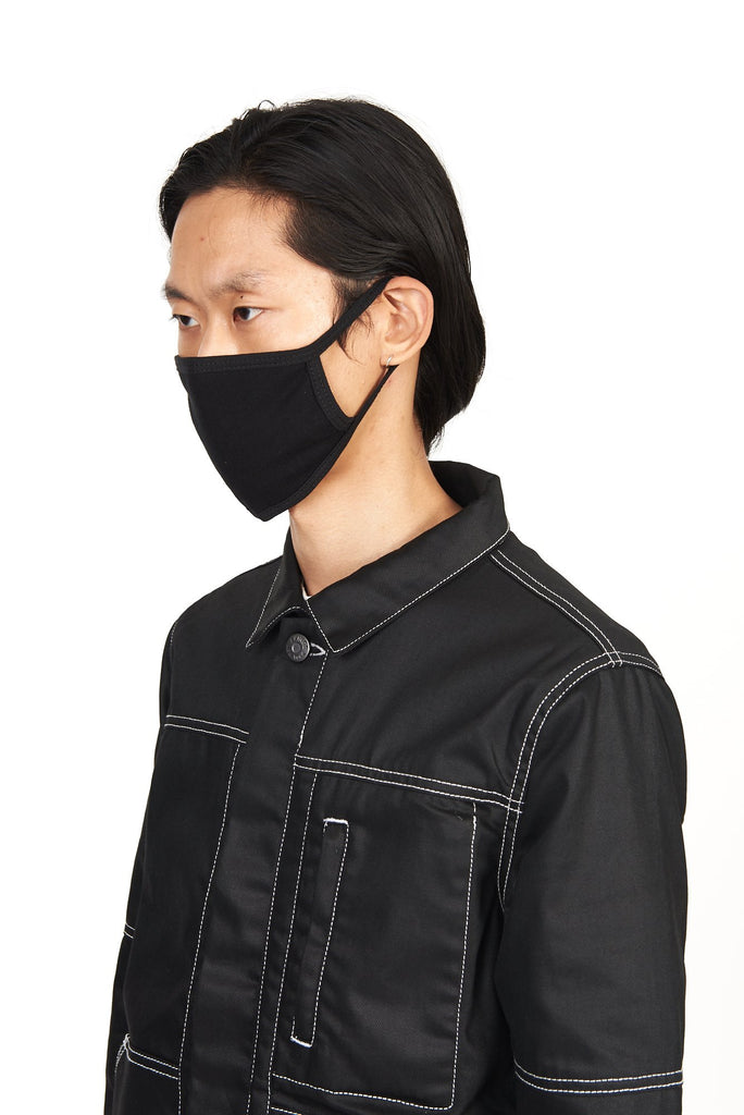side profile shot of model wearing the akings cotton face mask in black