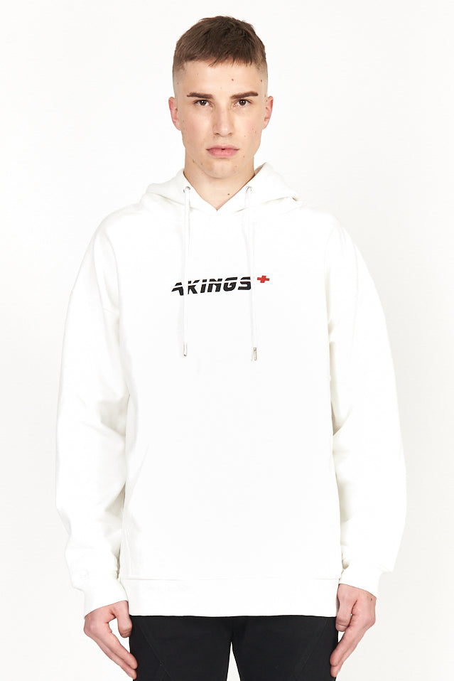 upper body shot of model wearing first aid white hoody featuring akings logo on chest