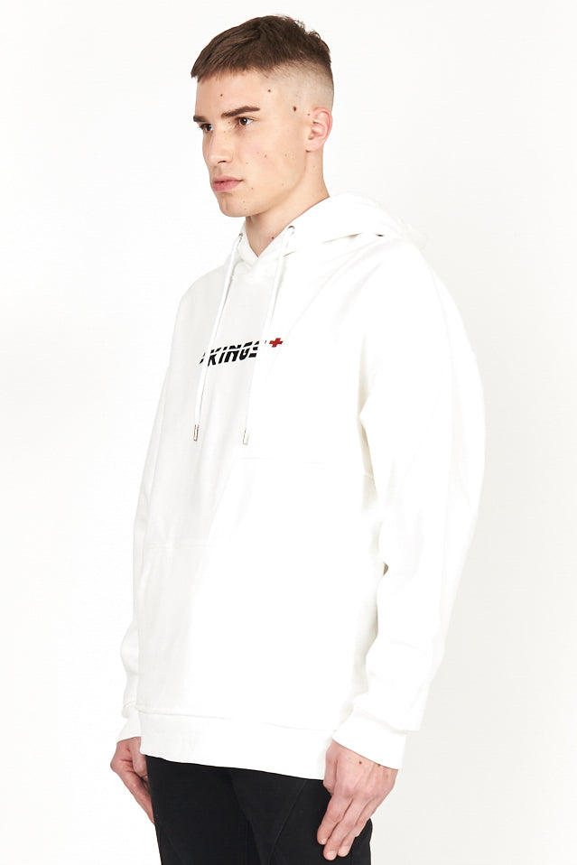 angled shot of model wearing the first aid white hoody