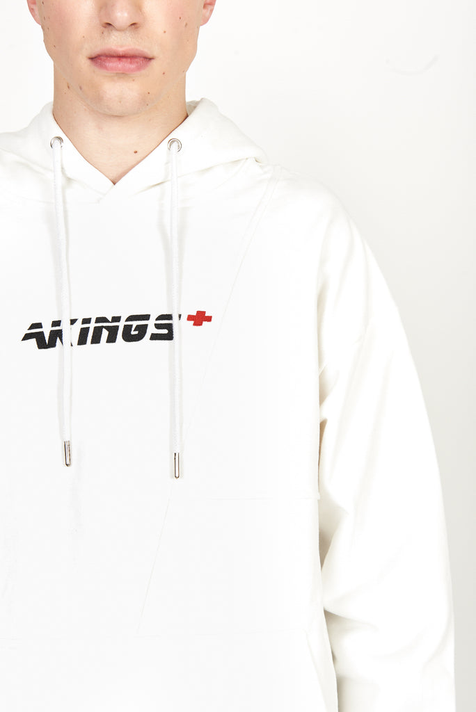 close up shot of the first aid white hoody shown on model