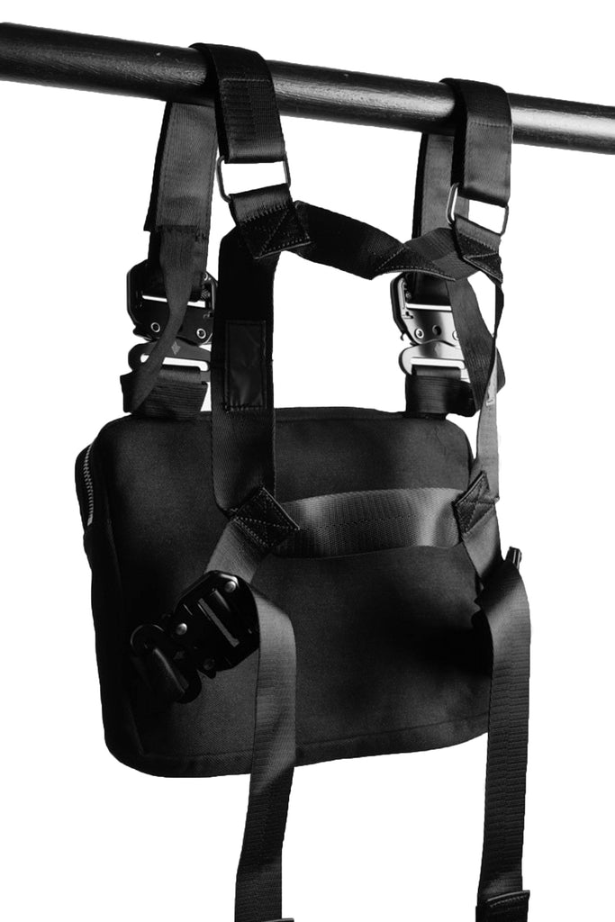 angled shot of the back of the ak01 chest bag. shows the straps of the bag.