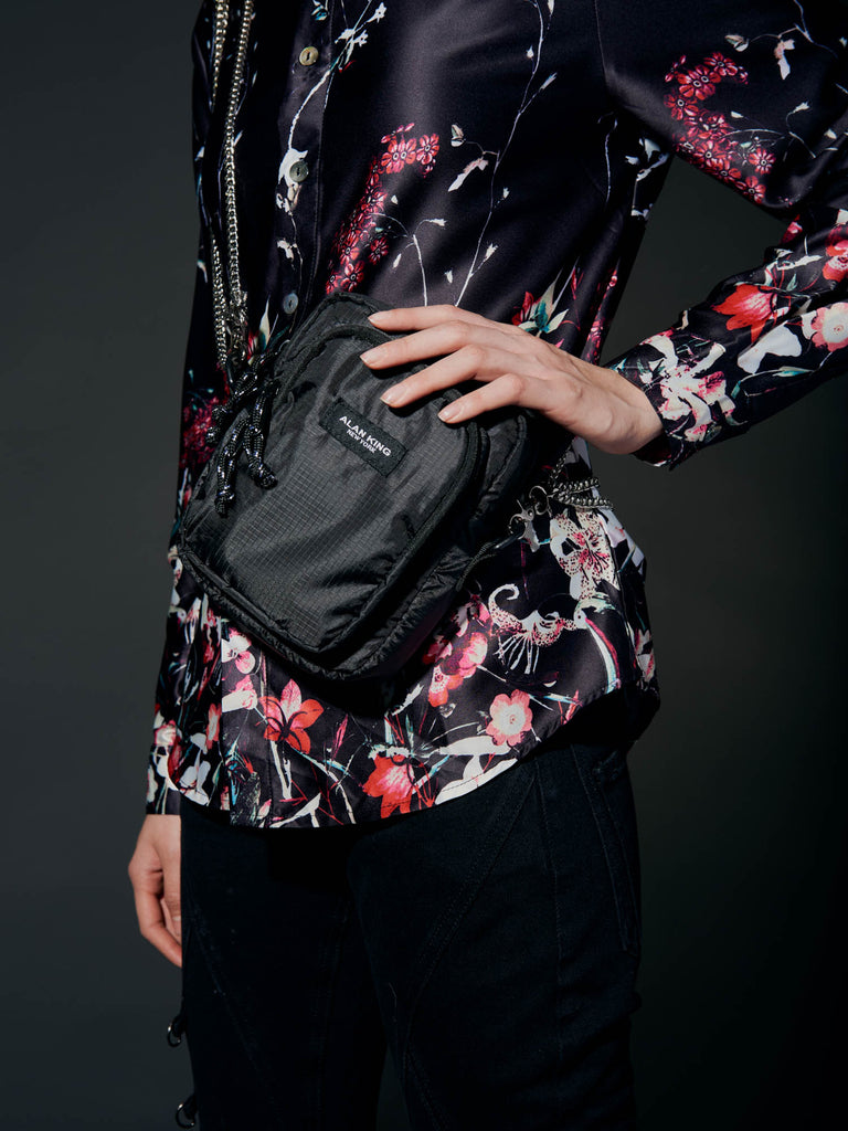 alan king shoulder bag on model paired with the tokyo sakura button down