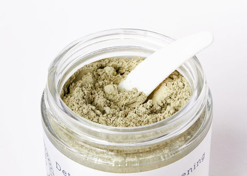 Open jar of green clay mask from Hello Wellness Naturals. Excellent for extracting excess sebum from oily skin & tightening.