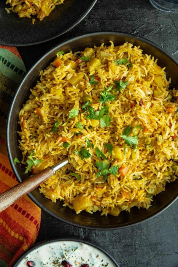 Lockdown Vegetable Biryani  with yoghurt Raita made of Cucumber, tomato and onions - portion for 1.