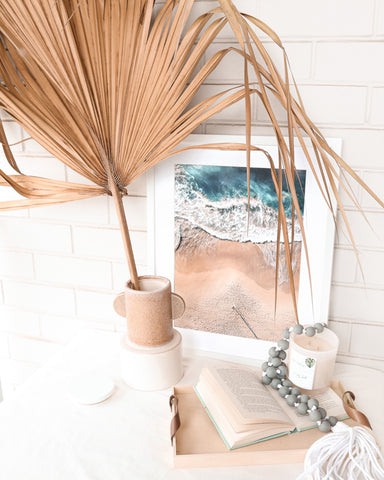 Coastal Beach Artwork with other Nautical home wares decorating the table