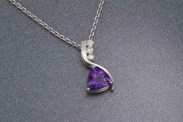Fine amethyst trillon 14kw pendant with diamonds