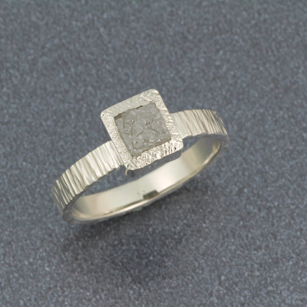 14k white gold ring with natural cube diamond