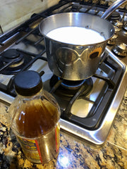 Simmering the milk for cheese making