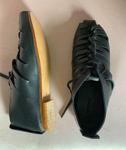 Sample black leather flats