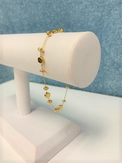 Gold Bracelet with Multi Size Disc Stations