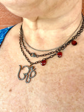 "Oxidized ""OM"" Necklace with Garnet Accents"