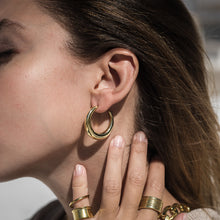 Load image into Gallery viewer, girl with brass gold plated diaz earrings
