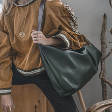 Load image into Gallery viewer, woman is holding handmade leather bag zanadu-green