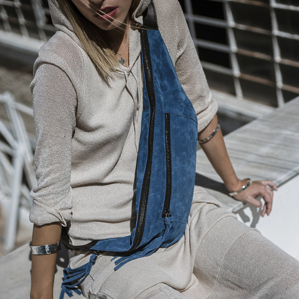 woman with white dress wearing 3rd-floor-handmade-leather-beltbag-bravado-blue by 3rd-floor