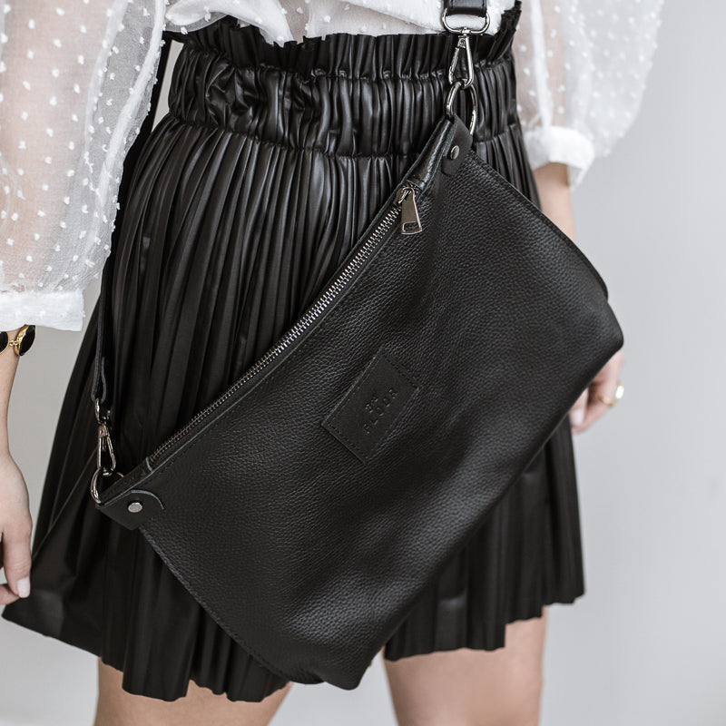 close up, woman wearing, city clutch leather bag,by 3rd-floor, workshop