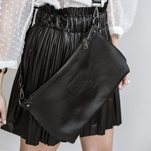 Load image into Gallery viewer, close up, woman wearing, city clutch leather bag,by 3rd-floor, workshop