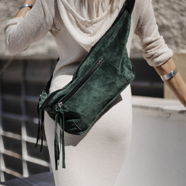 woman with white dress wearing 3rd-floor-handmade-leather-belt-bag-bravado-ever-green by 3rd-floor