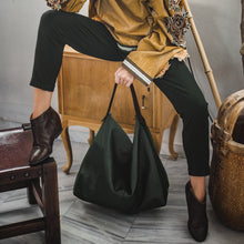 Load image into Gallery viewer, girl holding handmade leather bag xanadu -green