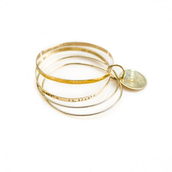 Journey gold plated bangle bracelet stamped with longitude and latitude coordinates bracelet by 3rd Floor Handmade Jewellery Journey gold plated bracelet stamped with longitude and latitude coordinates