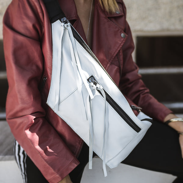 girl with red jacket wearing leather-bag, white-bravato handmade by 3rd-floor