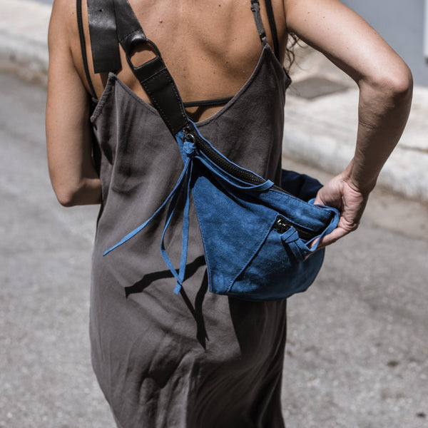 woman with gray dress walking wearing 3rd-floor-handmade-leather-beldbag-bravado-blue