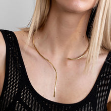 Load image into Gallery viewer, Girl in black tank top, wearing a Numinous, gold plated, handmade neckpiece