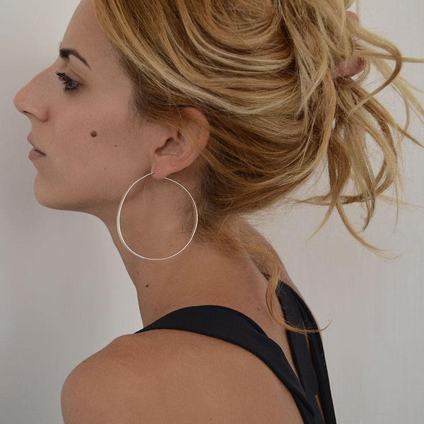 girl with Longone handcrafted hoop earrings by 3rdfloor jewels gold