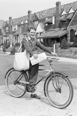 Person delivering papers on a bike