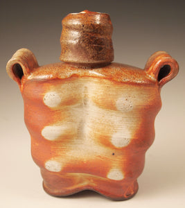 "Wood-fired stoneware whiskey flask with liner glaze. Handmade Pottery.  Unique design, yet functional. 7"" tall. 6"" wide.  3"" deep."