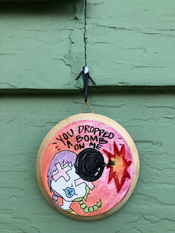 "You Dropped a Bomb on Me - 4x4"" painted wood block"
