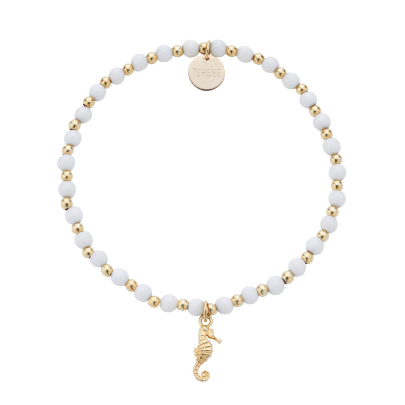 White and gold tiny bead seahorse charm bracelet