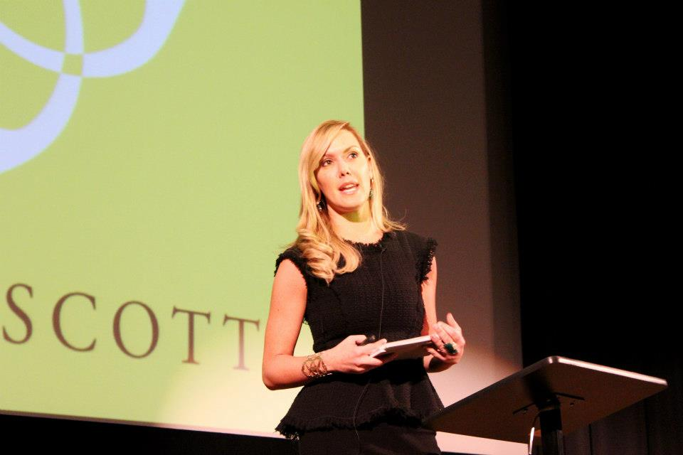 Kendra Scott speaking at conference.