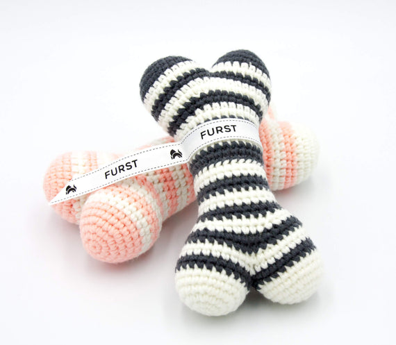 FURST - High-end Atlas dog toys in the form of bones in powder pink and anthracite colors