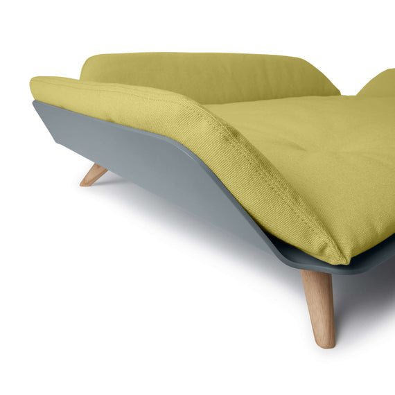 FURST - Corner glimpse of the Letto sofa for medium dogs in ginger color